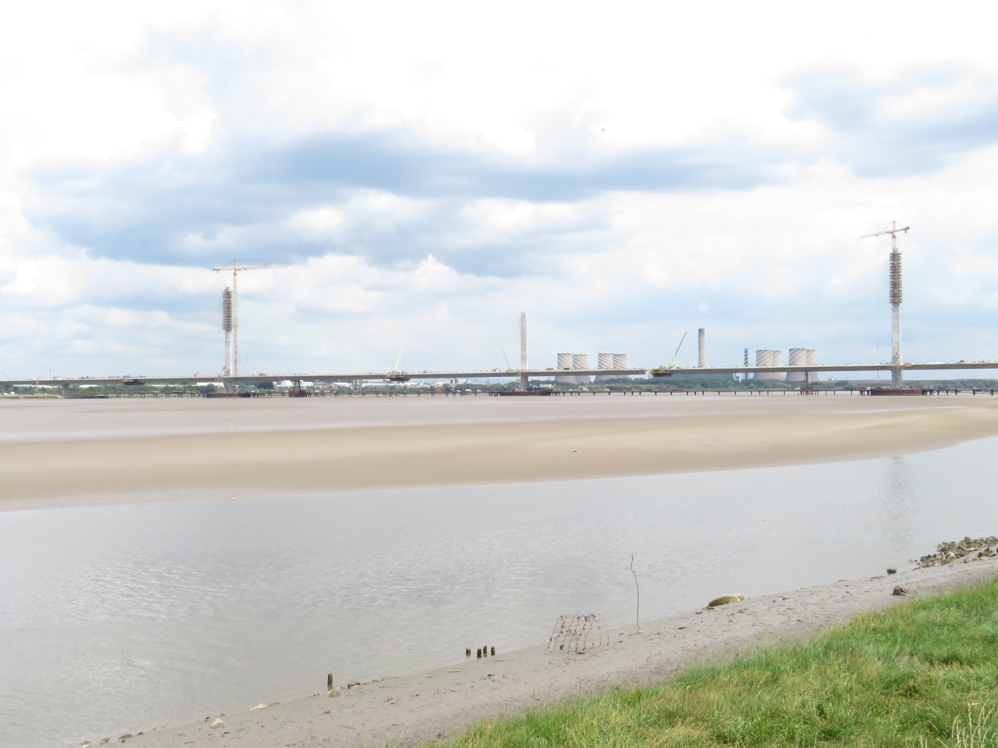 View across sandflats towards bridge.